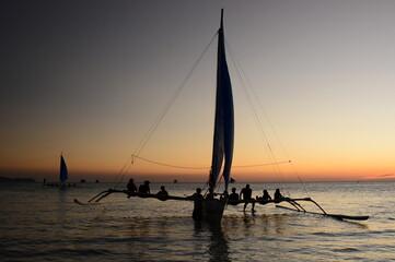 Paraw silhouette at sunset. White Beach. Boracay island. Western Visayas. Philippines