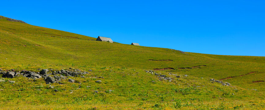 landscape from Aubrac, green meadow vallon and farm