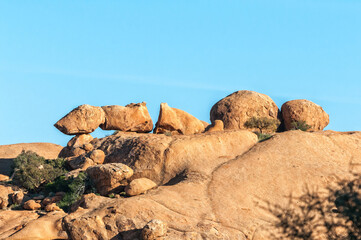 Granite rock formation, resembling a broken arrow, at greater Spitzkoppe