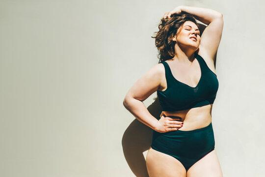 Beautiful plus size woman relaxing in underwear.