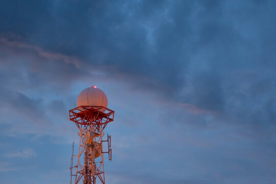 view of Weather radar or weather station with dramatic storm sky and clouds for Satellite communication antenna concept