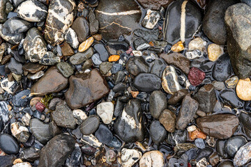 smooth pebbles by a river bank in Glarus, Switzerland