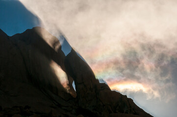 Reflections and diffraction visible in clouds at the Greater Spitzkoppe