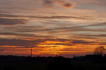 Obraz czerwony wschód słońca - fototapety do salonu