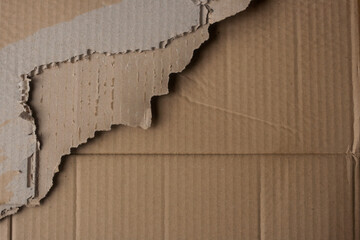broken paperboard layers
