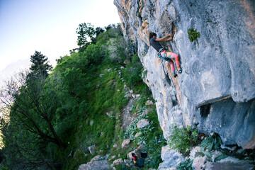A strong girl climbs a rock, Rock climbing in Turkey.