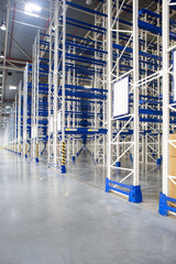 Wall Mural - Perspective of Huge distribution warehouse with high empty shelves.