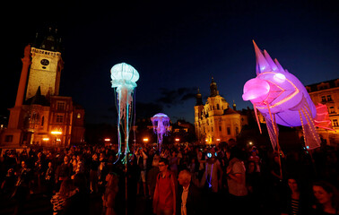 Artists perform at the Old Town Square during a street theater festival in Prague