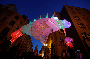 Artists perform during a street theater festival in Prague