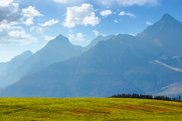 countryside summer landscape. rural fields rolling in to the distant high tatra mountain ridge in slovakia. great scenery on a sunny day