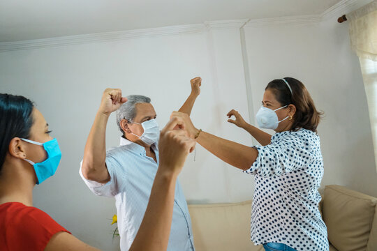People with face mask Attending Dance Class In Community Center
