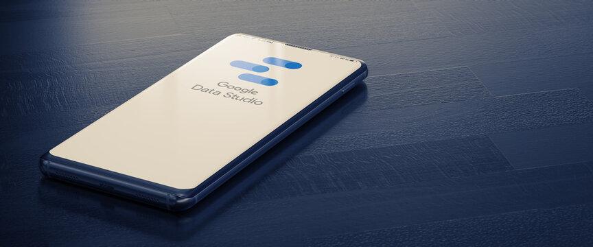 KYIV, UKRAINE-JANUARY, 2020: Google Data Studio on Cellphone Screen. A Smart Phone Lying on a Dark Surface with a Google Data Studio Application. Seo Business Concept