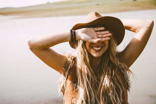 close up of a boho blonde girl outdoors in a sunny day