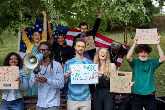mix race diverse american people holding legalize cannabis now protest poster, medical marijuana legalization, drugs consumption.