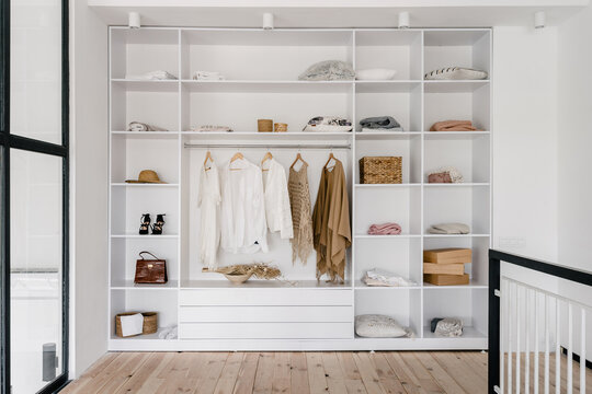 Modern and large wardrobe in dressing room