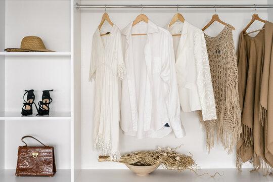 Modern dressing room with open wardrobe closet
