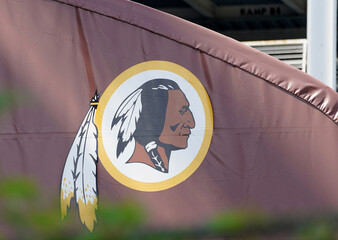 Washington Redskins logos are displayed after team name announcement at FedEx Field in Landover, Maryland