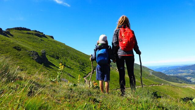 hiking trail, family with backpack- Plomb du Cantal, Auvergne-Cantal.