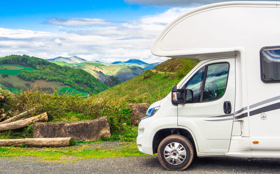 Partial view of a camper with a landscape of the Atlantic Pyrenees in the background, Nouvelle-Aquitaine, France