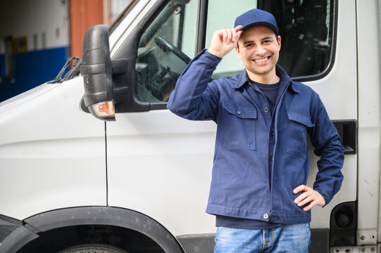 Portrait of a driver standing enar his van and smiling