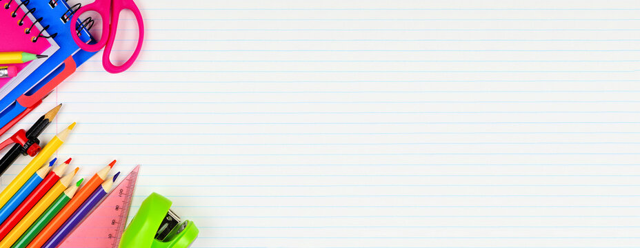 School supplies corner border. Top down view on a white lined paper banner background with copy space. Back to school concept.