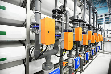 Reverse osmosis industrial water treatment station. Visual rhythm of pipes