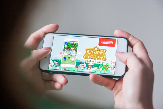 Los Angeles, California, USA - 25 February 2019: Hands holding a smartphone with Nintendo Animal Crossing game on display screen