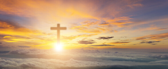 Conceptual wood cross or religion symbol over a sunset sky with clouds background for God. belief or resurrection of god and worship christian. Foggy and beautiful sky christian. Christian Religion.