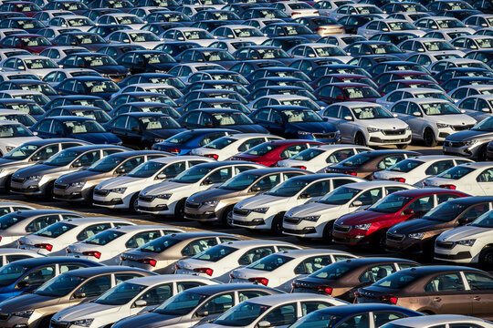 Group Rus, Russia, Kaluga - MAY 25, 2020: Rows of a new cars parked in a distribution center. Parking in the open air.