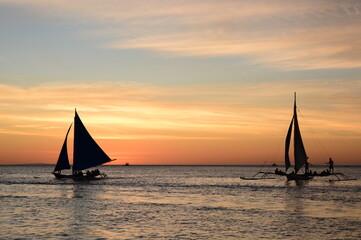 Sailing boats silhouette at sunset. Boracay island. Western Visayas. Philippines