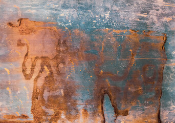 Oxidized metal background. Aged texture. Rusty orange blue distressed wall surface.