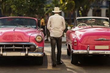 Fotobehang Havana Amazing old american car on streets of Havana with colourful buildings in background. Havana, Cuba.