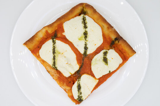 Grandma Pizza Style Slice with Mozzarella Cheese on a White Plate with a White Background