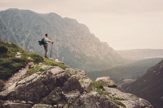 Man Traveler on mountain summit enjoying aerial view. Slovakia, Europe.