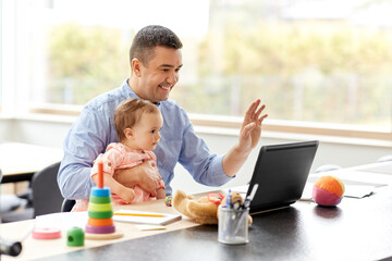 Printed kitchen splashbacks Akt remote job, multi-tasking and family concept - middle-aged father with baby working on laptop at home office