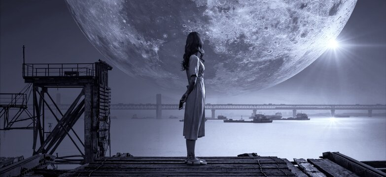 silhouette of a woman standing staring at the moon