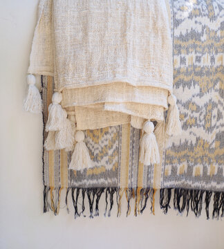 soft knit beage blankets on white background. Details of modern boho, scandinavian style .