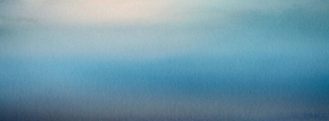 Abstract watercolor blue blur nature texture paper horizontal background.