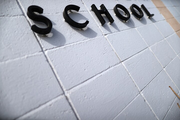 A school sign is seen during summer break renovations and installation of social distancing measures at St. Joseph's School, amid the outbreak of the coronavirus disease (COVID-19), in La Puente, near Los Angeles