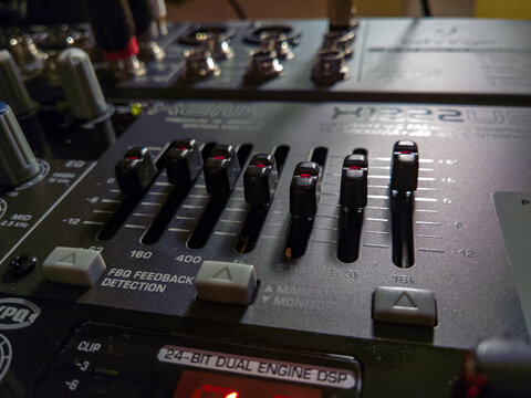Close-up on the equalizer section of the mixer Behringer Xenyx X1222