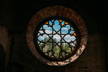 Fototapeta Round stained glass window in old abandoned castle obraz