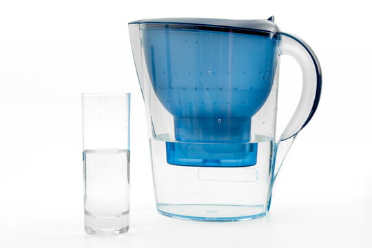 Improve water purity and home filter concept with plastic pitcher and full glass isolated on white background