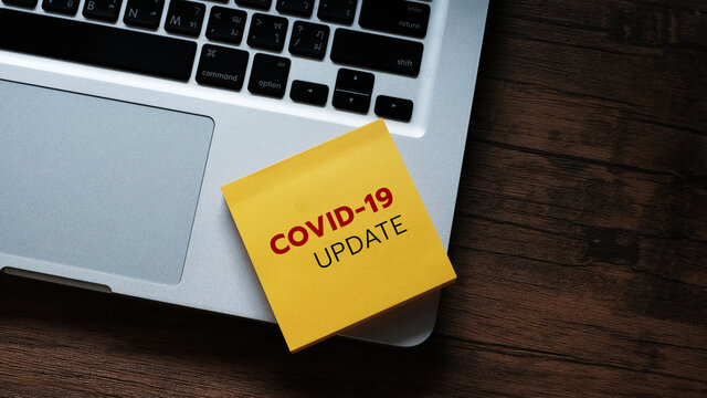 COVID-19 UPDATE text  on laptop keyboard. Covid-19 or Coronavirus Concept.