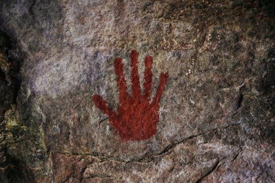 A hand print from a Maasai initiation ritual is seen at the Munjiriri cave near Nairobi