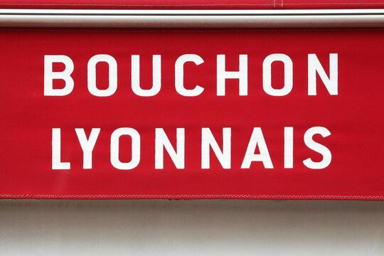 Bouchon Lyonnais restaurant sign on wall