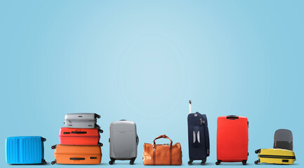 Large multicolored tourist suitcases stand in a row