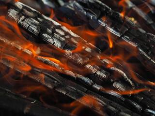 Fotobehang Brandhout textuur firewood burns in a fireplace