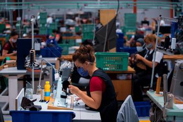 Shoe making process in footwear factory.