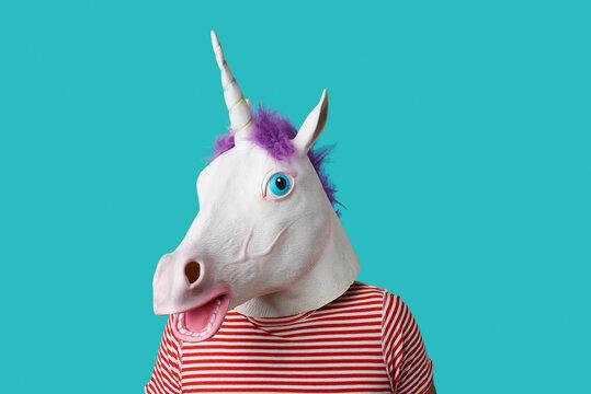 man wearing a unicorn mask