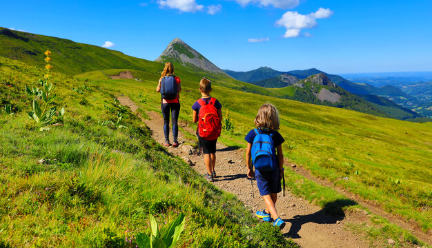 family backpacker hiking amazing mountain in France- Cantal, Auvergne, Massif Central